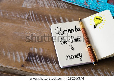 Handwritten text Remember The Time Is Money with fountain pen on notebook. Concept image with copy space available. - stock photo