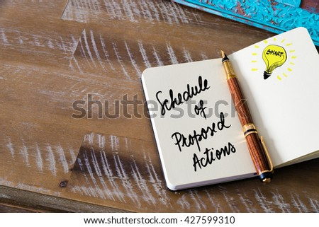 Handwritten text Schedule Of Proposed Actions with fountain pen on notebook. Concept image with copy space available. - stock photo