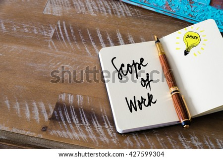 Handwritten text Scope Of Work with fountain pen on notebook. Concept image with copy space available. - stock photo