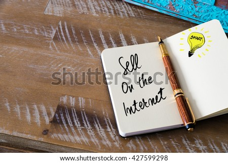 Handwritten text Sell On The Internet with fountain pen on notebook. Concept image with copy space available. - stock photo