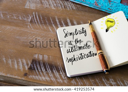 Handwritten text Simplicity is the ultimate sophistication with fountain pen on notebook. Concept image with copy space available. - stock photo