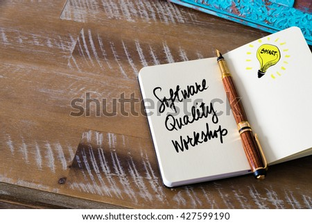 Handwritten text Software Quality Workshop with fountain pen on notebook. Concept image with copy space available. - stock photo