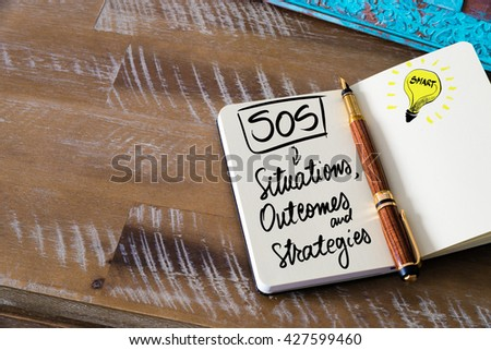 Handwritten text SOS as Situations, Outcomes and Strategies with fountain pen on notebook. Concept image with copy space available. - stock photo