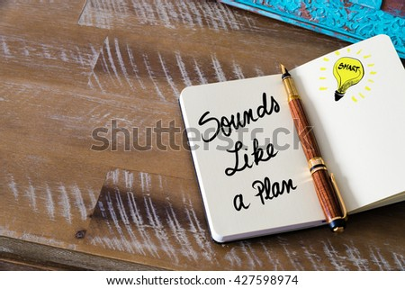 Handwritten text Sounds Like A Plan with fountain pen on notebook. Concept image with copy space available. - stock photo