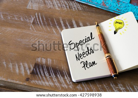 Handwritten text Special Needs Plan with fountain pen on notebook. Concept image with copy space available. - stock photo