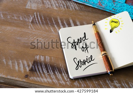 Handwritten text Speed Of Service with fountain pen on notebook. Concept image with copy space available. - stock photo