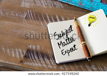 Handwritten text Subject Matter Expert with fountain pen on notebook. Concept image with copy space available. - stock photo