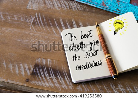 Handwritten text The Best Doctor Gives The Least Medicines with fountain pen on notebook. Concept image with copy space available. - stock photo