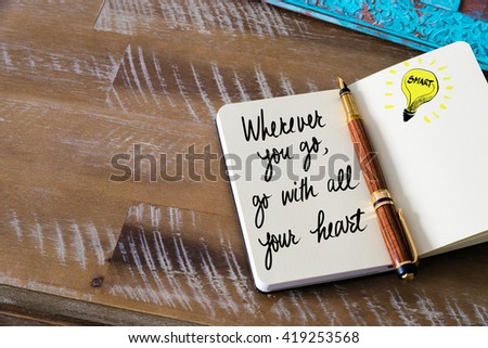 Handwritten text Wherever you Go, Go With All Your Heart with fountain pen on notebook. Concept image with copy space available. - stock photo