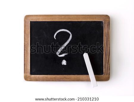 Handwritten with chalk on a blackboard: question mark - stock photo