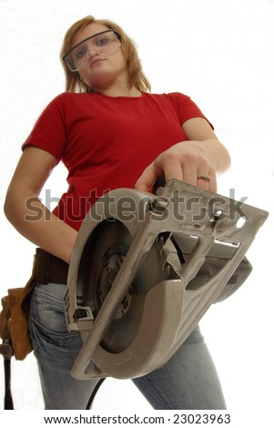 Handy girl gets ready to saw.  Focus on the the saw