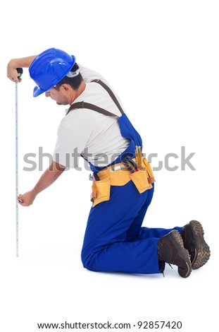 Handy man or construction worker measuring - isolated with a bit of shadow - stock photo