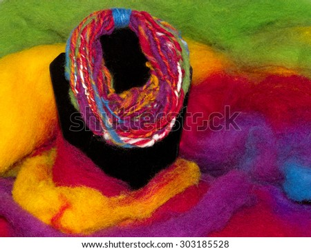 Handycraft necklace , homespun with a handspindle on a colorful sheep fleece - stock photo