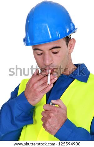 Handyman about to light a smoke. - stock photo