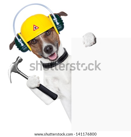 handyman dog with a hammer behind a banner - stock photo