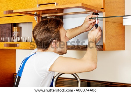 fixing kitchen cabinets handyman fixing kitchens cabinet screwdriver stock photo 15468