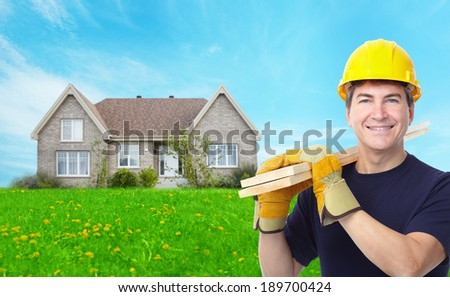 Handyman near new house. Renovation concept background. - stock photo