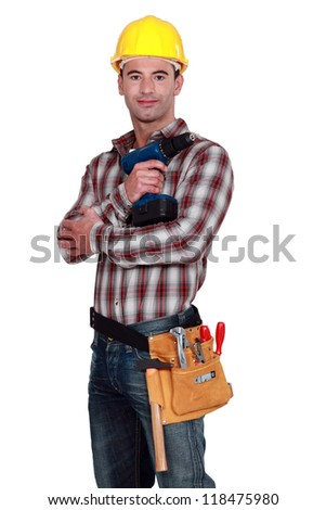 Handyman posing with cordless drill - stock photo