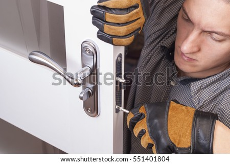 handyman repair the door lock in the room & Handyman Stock Images Royalty-Free Images u0026 Vectors | Shutterstock pezcame.com