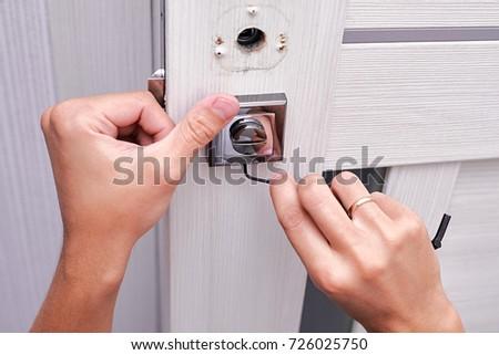 handyman repair the door lock in the room Man fixing lock with screwdriver Close & Handyman Repair Door Lock Room Man Stock Photo 726025750 - Shutterstock