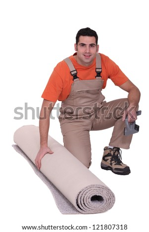 handyman with a carpet roll