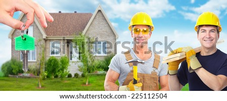 Handyman with a hammer. House renovation and construction background. - stock photo