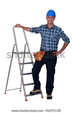 Handyman with step-ladder on white background - stock photo
