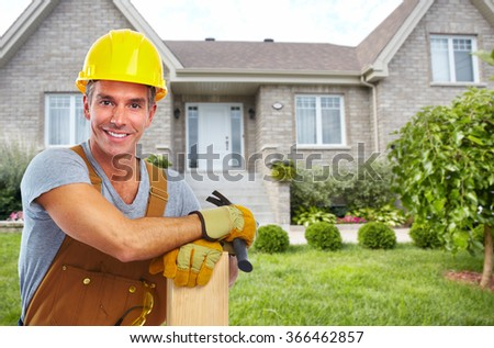 Handyman with wood and hammer.