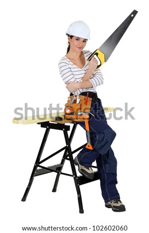 handywoman with a saw - stock photo