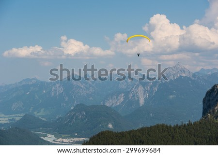 Hang glider flying in the Alps, Germany - stock photo