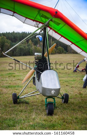 hang-glider staying on a ground - stock photo