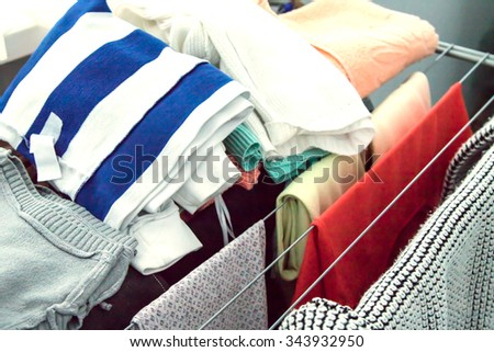 hang on a hanger clothing items - stock photo