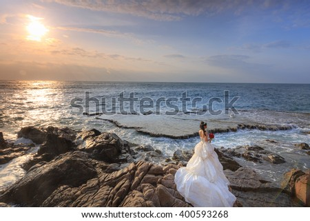 Hang Rai beach, Ninh Thuan province, Vietnam - March 27, 2016 : happy bride on the beach near the ocean at ecotourism at Hang Rai Vietnam, Phan Rang city, Ninh Thuan, coastal countryside, amazing
