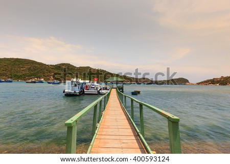 Hang Rai beach, Ninh Thuan province, Vietnam - March 27, 2016: pier to the sea at Vietnamese beach, Ecotourism at Hang Rai Vietnam, Phan Rang city, Ninh Thuan, coastal countryside, amazing ancient