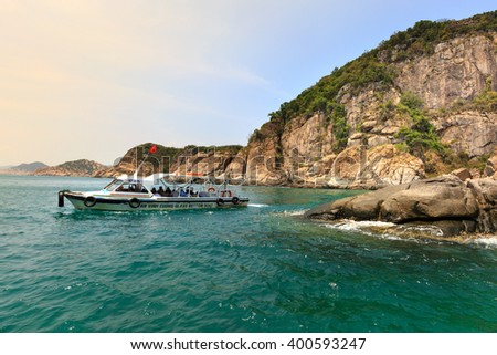 Hang Rai beach, Ninh Thuan province, Vietnam - March 27, 2016: Tourist boat at Vietnamese beach, Ecotourism at Hang Rai Vietnam, Phan Rang city, Ninh Thuan, coastal countryside, amazing ancient coral