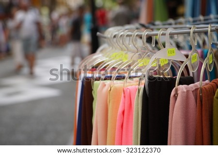 hanged clothes in order to sale