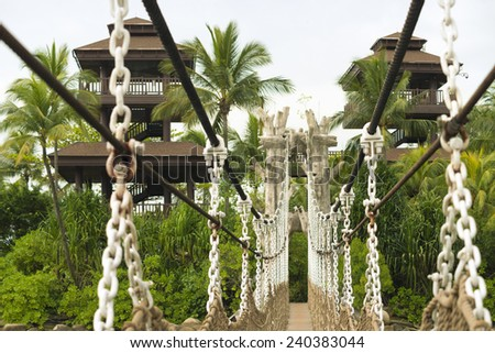 hanged rope-way leading to the observation towers at the famous Sentosa island in Singapore with focus on bridge  - stock photo
