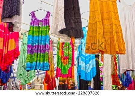 Hanged women dresses in local market - stock photo