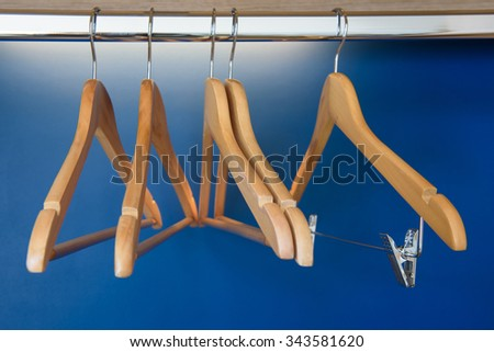 Hangers on blue background