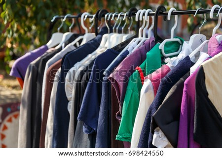 Hangers With Mens And Womens Clothing At The Garage Sale