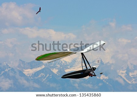 Hanggliding in swiss alps, Switzerland - stock photo