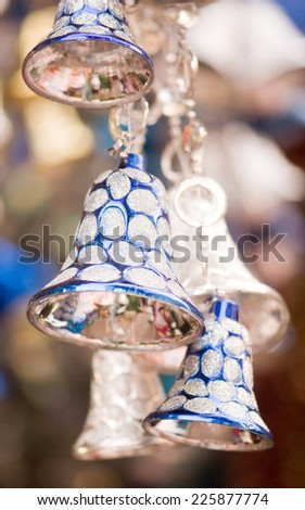 Hanging blue and silver colored jingle bells during Christmas fesival - stock photo