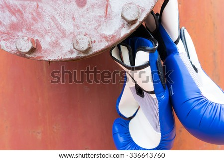 Hanging blue boxing gloves