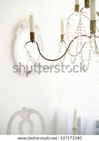 Hanging chandelier with candles - stock photo