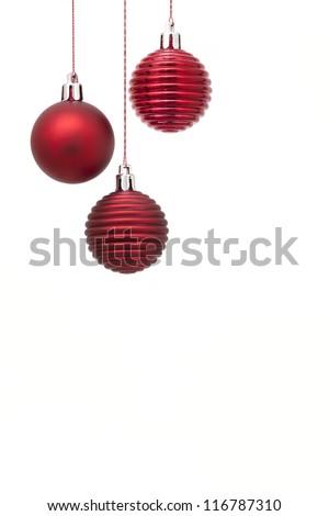 Hanging christmas balls on white background - stock photo