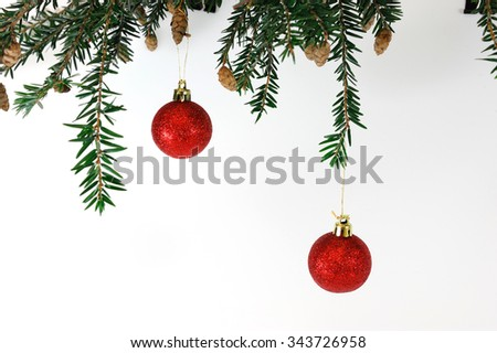 hanging Christmas baubles on pine branch - stock photo