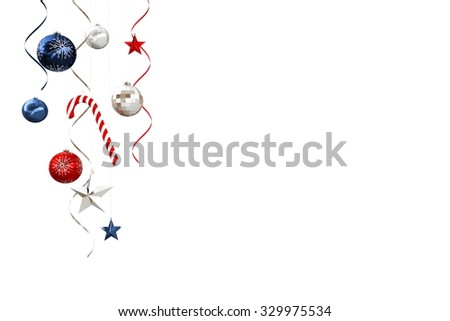 Hanging christmas decorations and streamers on white background