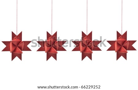 hanging christmas star shaped decorations on white background - stock photo