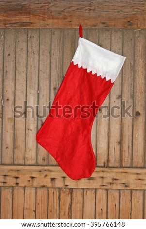 Hanging Christmas Stocking on wooden background