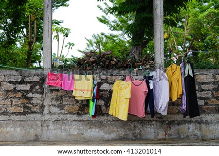 Hanging clothes in the street.